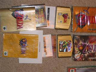 Atari SNES NES N64 boxes manuals games systems for sale